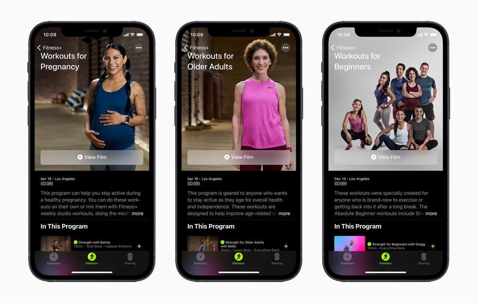 Apple Fitness+ Workouts for Pregnancy, Workouts for Older Adults, and Workouts for Beginners each displayed on separate iPhone 12 models.