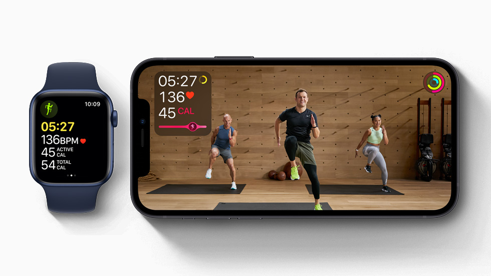 Apple Fitness+ on iPhone 12 and a workout in progress on Apple Watch Series 6.