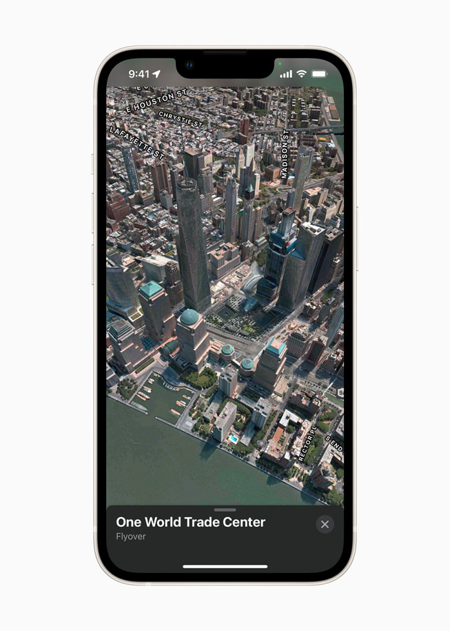 Apple Maps on iPhone shows a Flyover view of One World Trade Center in New York City.