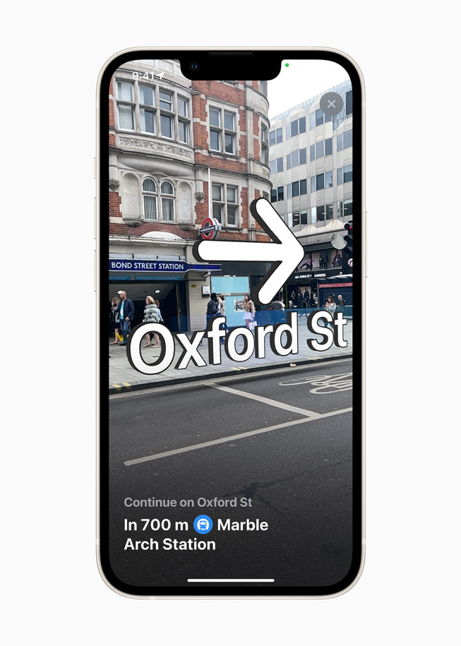 iPhone shows step-by-step walking guidance in augmented reality in Apple Maps in iOS 15.