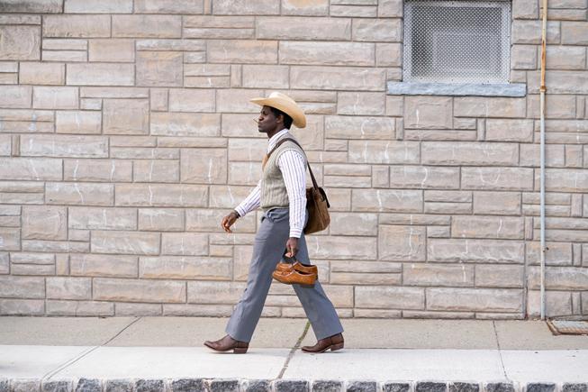 """Conphidance walking down the street in """"Little America."""""""