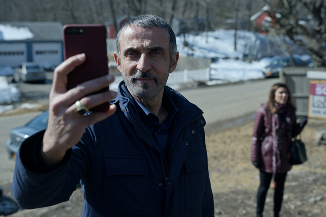 "Shaun Toub taking a picture and in ""Little America."""