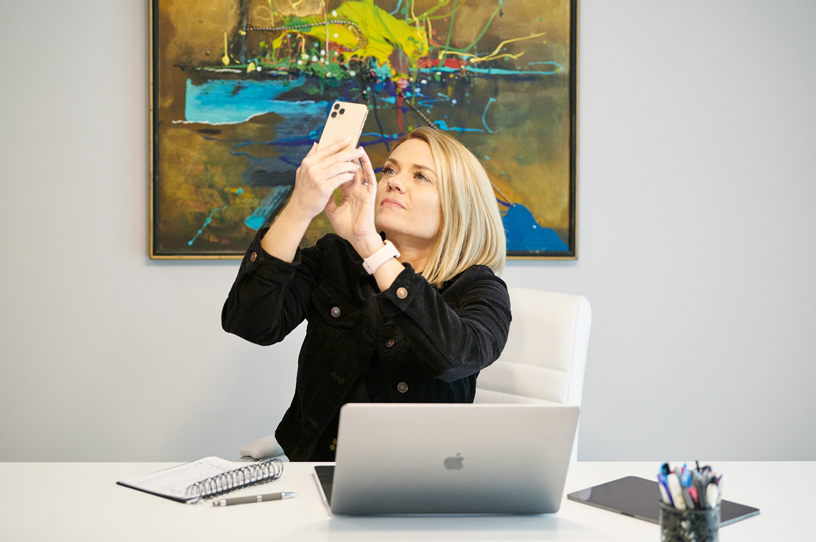 Sarah Hill in her office using the Healium AR app on iPhone 11 Pro.