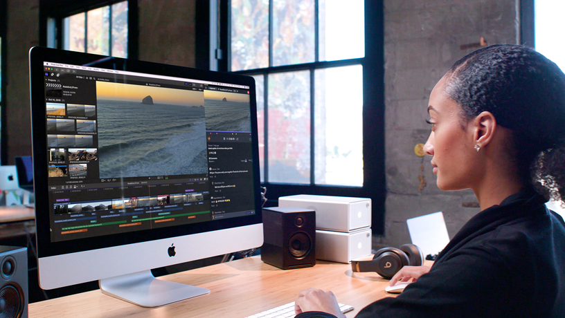 Woman using Final Cut Pro X on iMac.