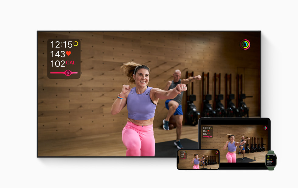 A trainer shows workout moves in Apple Fitness+.