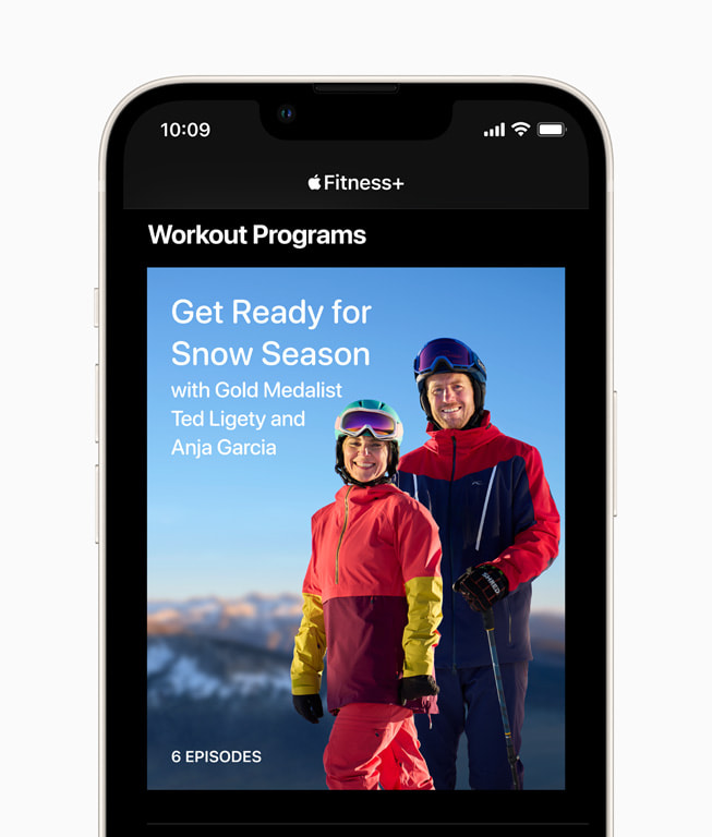An iPhone screen shows the home screen for Get Ready for Snow Season with Ted Ligety and Anja Garcia in Fitness+.