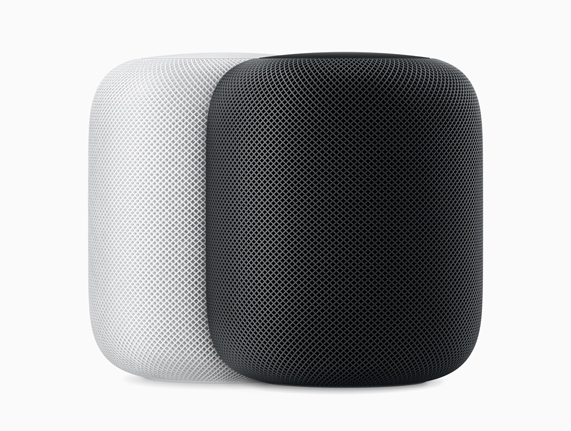 HomePod speakers in white and space grey.
