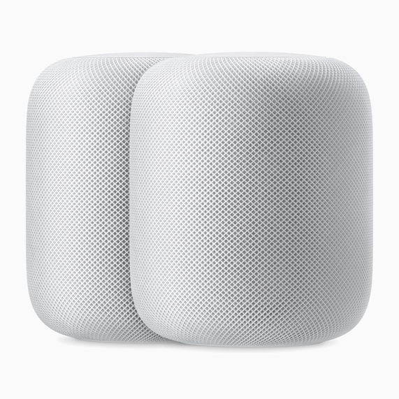 Two white HomePod speakers.