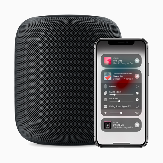 HomePod speaker and iPhone X displaying Control Center.