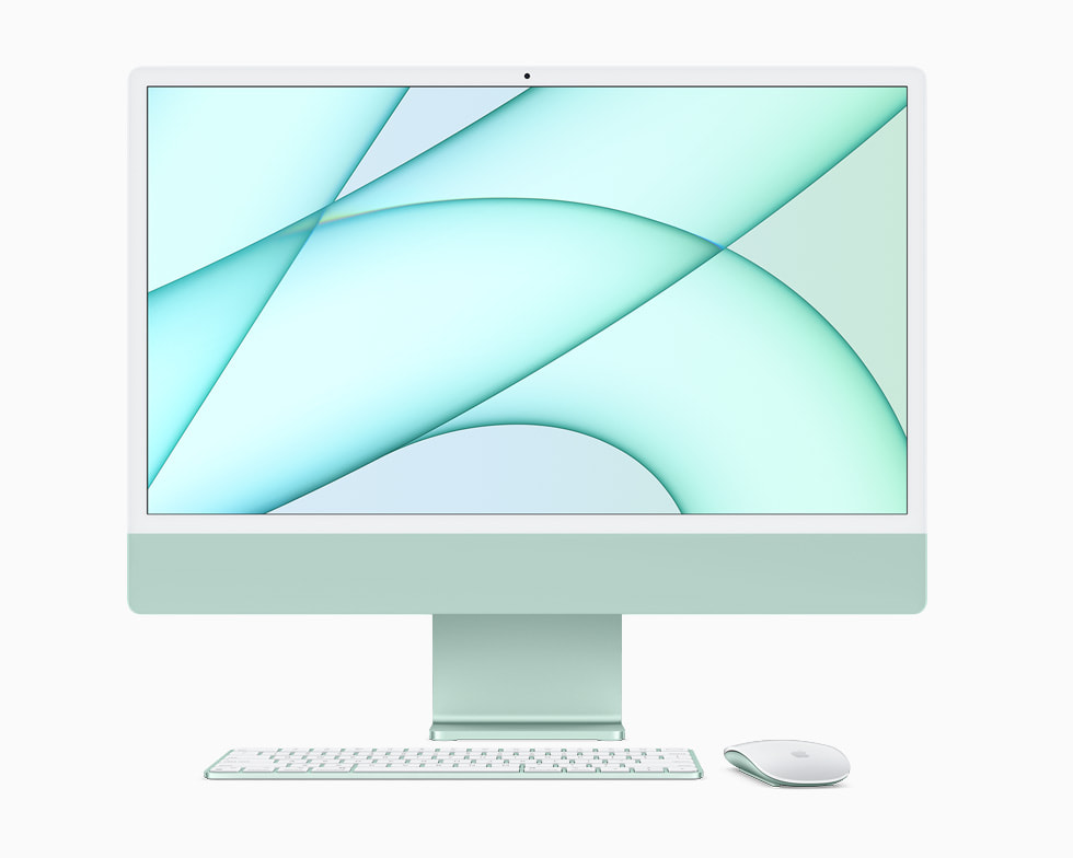 Green iMac displayed with Magic Keyboard and Magic Mouse.