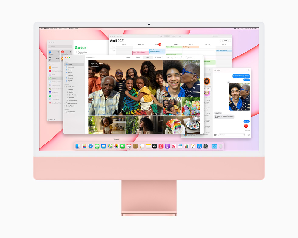 Multiple apps launched onscreen demonstrate the power and performance of M1 and macOS on a pink iMac.