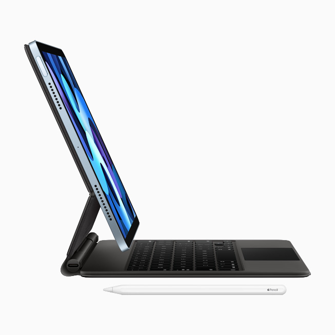 Vue de profil du nouvel iPad Air, du Magic Keyboard avec pavé tactile intégré et de l'Apple Pencil.