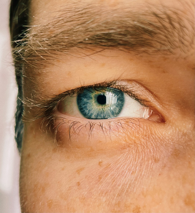A close-up shot of a person's blue eye.
