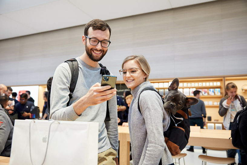 Customers use the new iPhone 11 Pro Max.