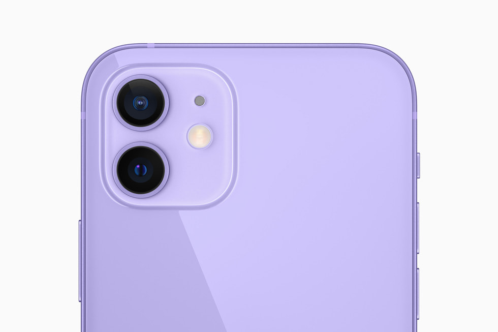 The dual-camera system on the purple iPhone 12.