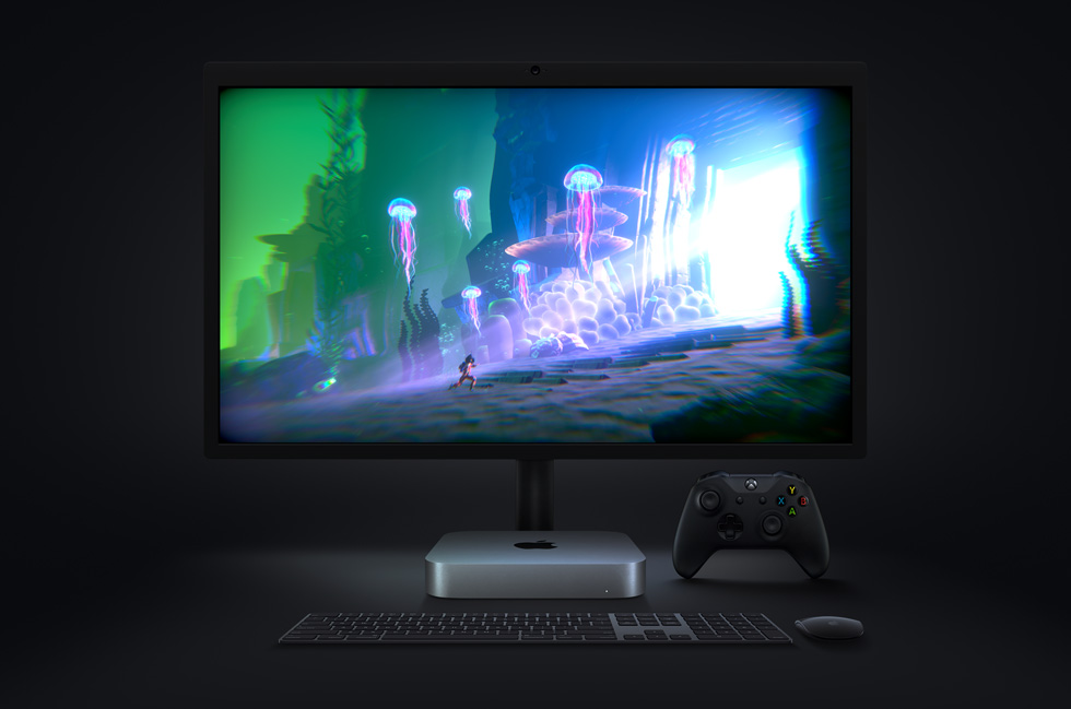"The video game ""Little Orpheus"", running on Mac mini, is displayed on a monitor, with a wireless keyboard and mouse and Xbox controller nearby."