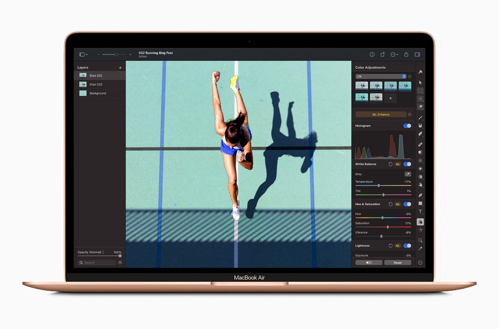 A photo editing screen in Photoshop is displayed on MacBook Air.