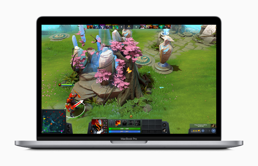 Dota 2 gameplay displayed on MacBook Pro.