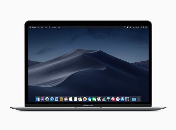 MacBook Air muestra MacOS Mojave Dark Mode en pantalla.