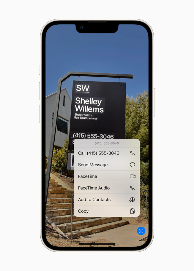 iOS 15's Live Text using on-device intelligence to identify text on a photo on a starlight iPhone 13.