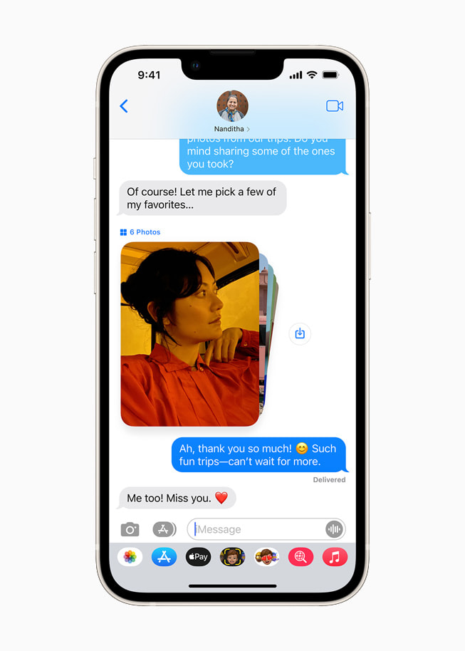 iOS 15's Shared with You feature to share photos in Messages on a starlight iPhone 13.