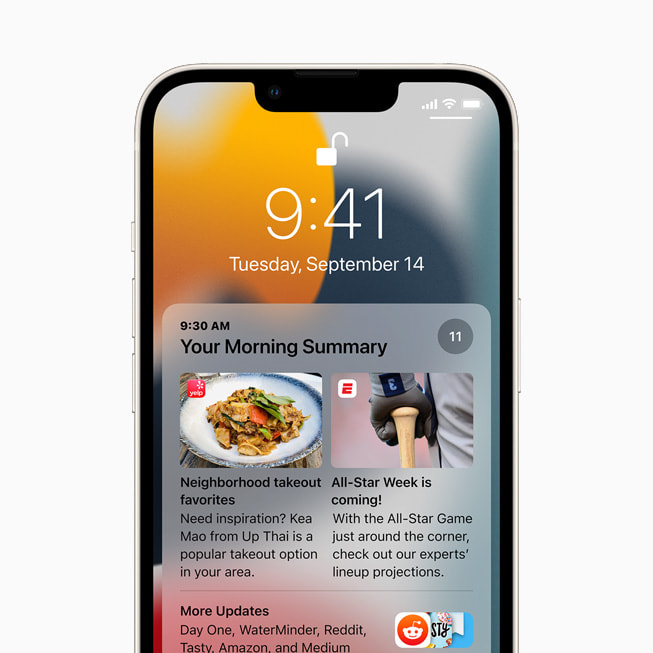 iOS 15's notification summary on a starlight iPhone 13's Lock Screen.