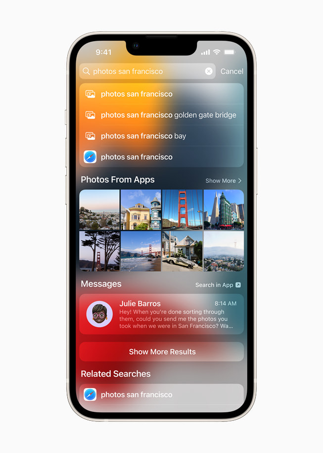 iOS 15's Spotlight searching photos by location on a starlight iPhone 13.