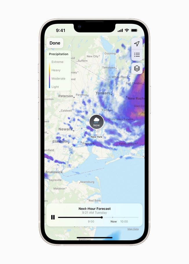 iOS 15's redesigned Weather app showing a dynamic full-screen map on a starlight iPhone 13.