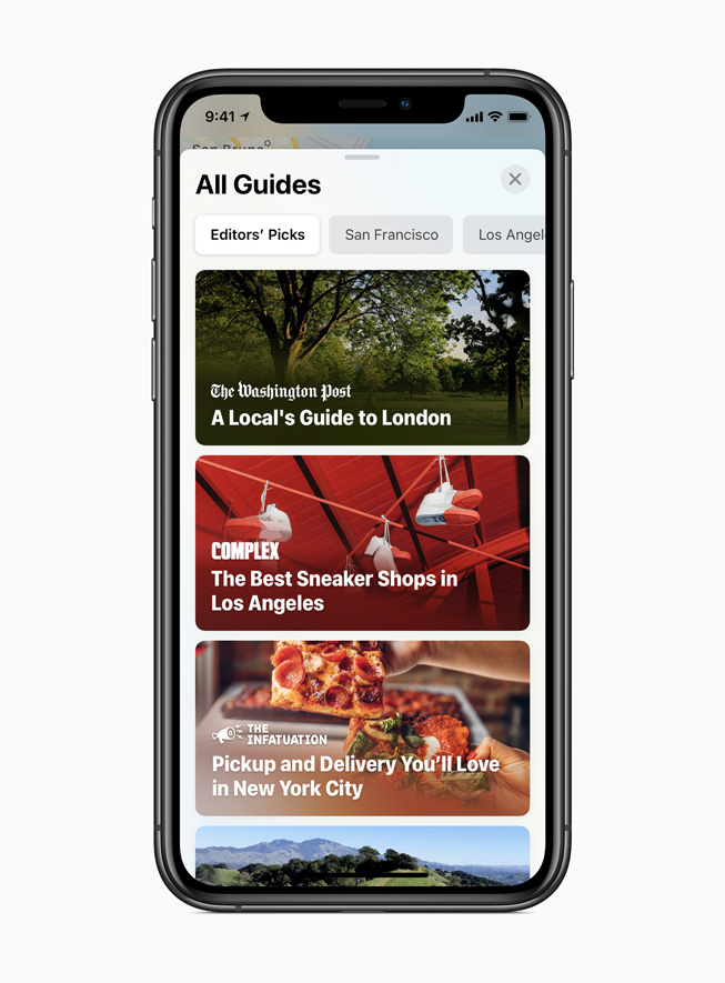 The new Guides feature in Maps displayed on iPhone 11 Pro.