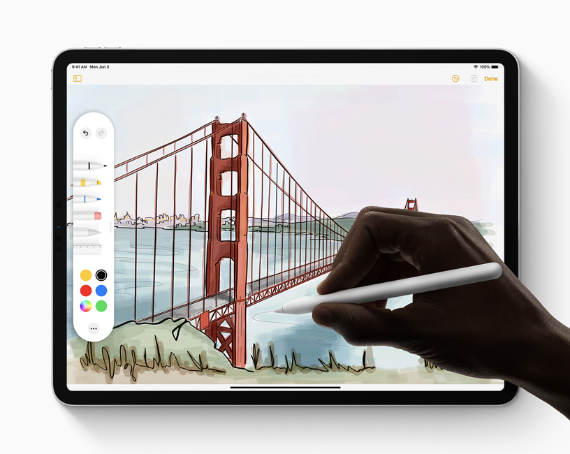 A person using Apple Pencil and the new tool palette to complete a drawing in iPadOS on iPad.