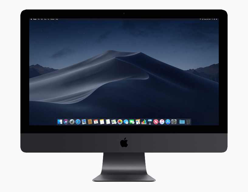 iMac Pro showing Dynamic Desktop at night, local time, with dock.