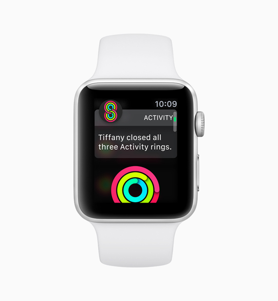 White Apple Watch displaying activity competition software
