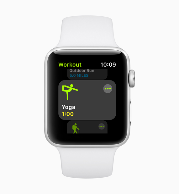 New yoga workout screen displayed on white Apple Watch
