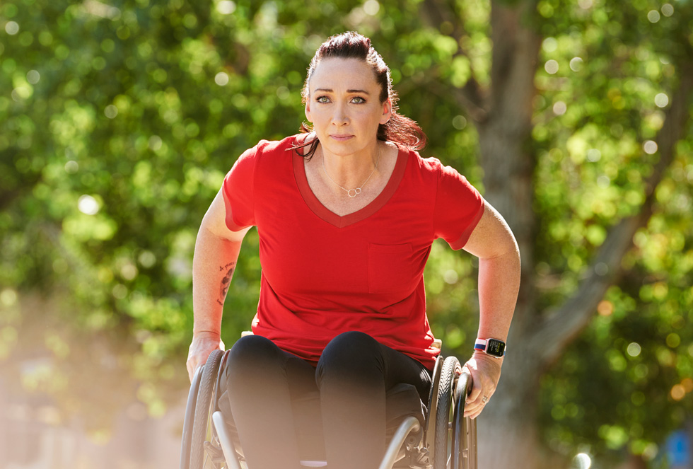Amy Van Dyken rolling on her wheelchair.