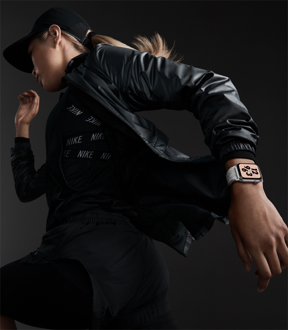 A woman wearing the new Apple Watch Nike+.