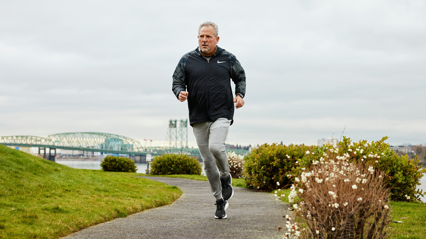 Bob March running outdoors.