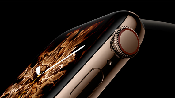 The gold stainless steel Apple Watch Series 4, displaying the new Fire watch face.