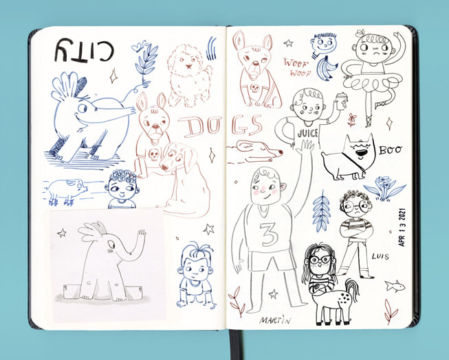 An artist's open sketchbook is filled with cartoon drawings made in ink.