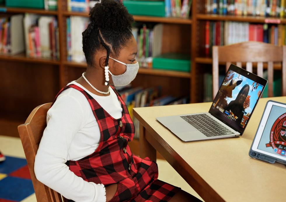 Katilynn Calhoun uses MacBook Air to interview Reveign Lee.
