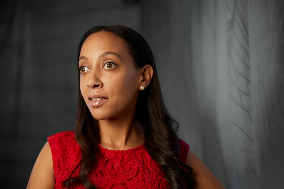 Haben Girma wearing a red lace blouse.