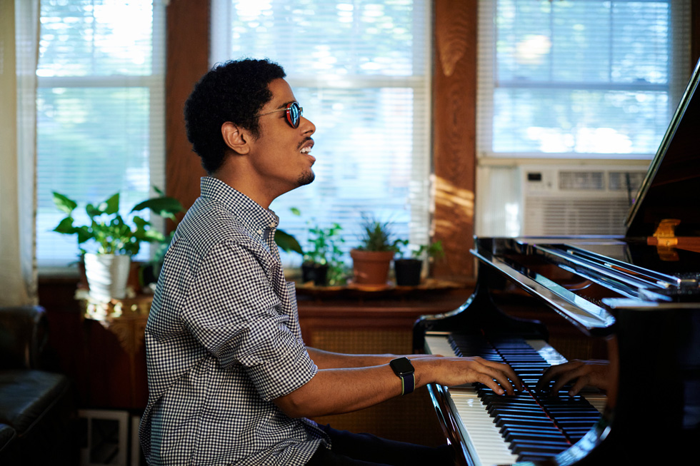 Mathew Whitaker performs on the piano at his home.