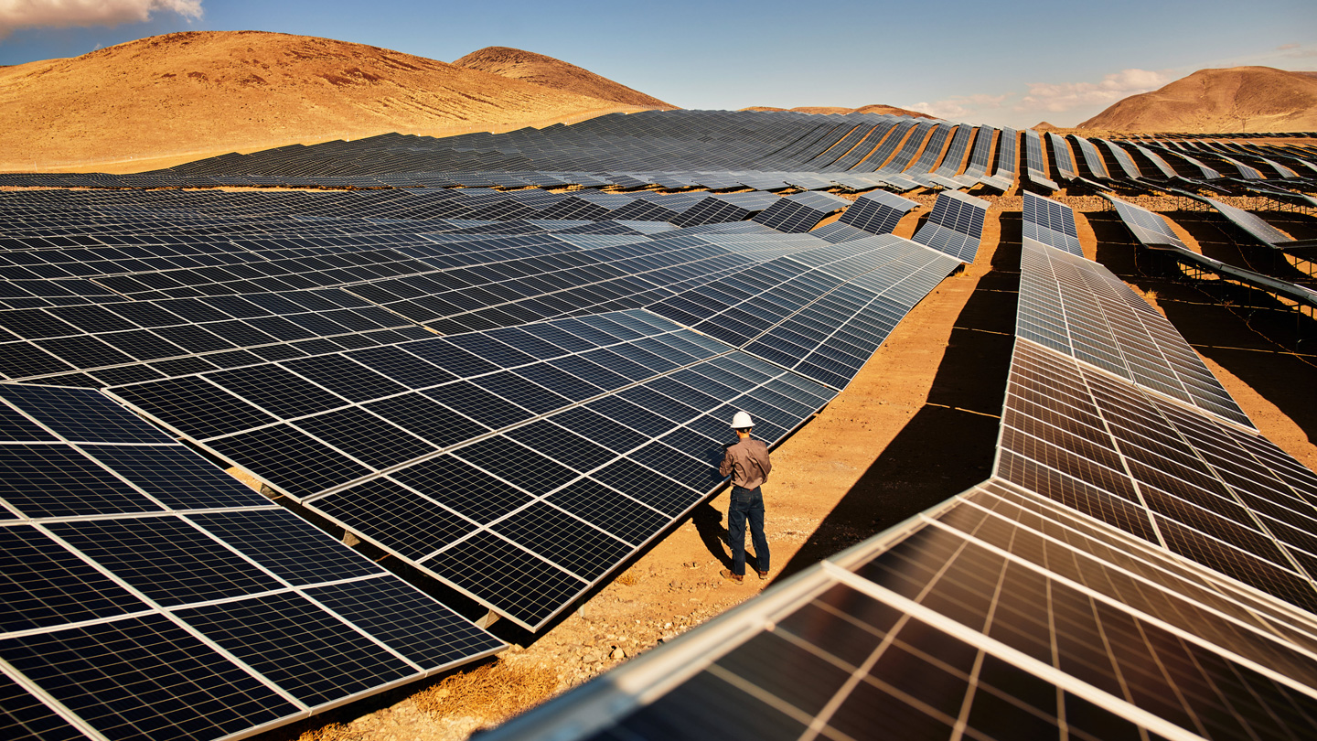 A technician inspects solar panels at the Turquoise solar farm in Nevada.