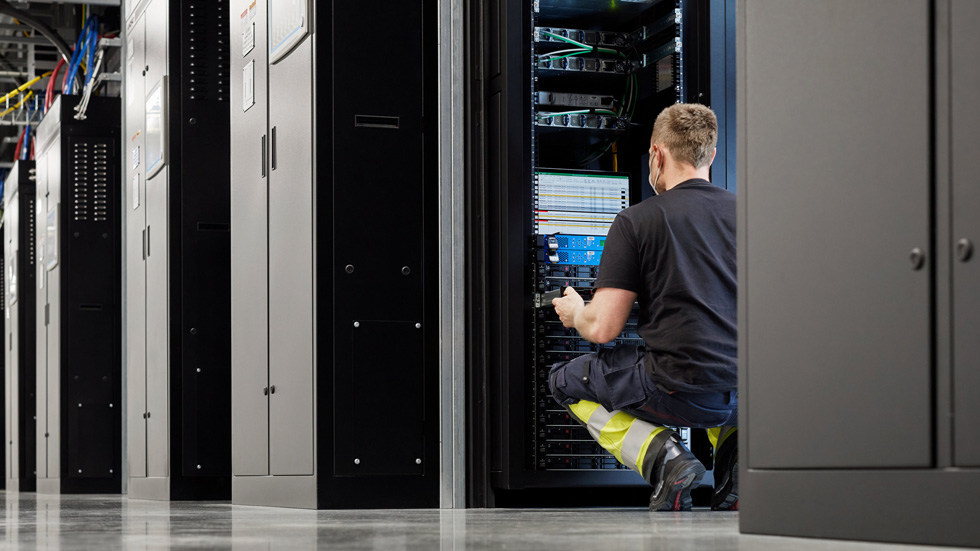 A worker in a server room at the Viborg data centre.