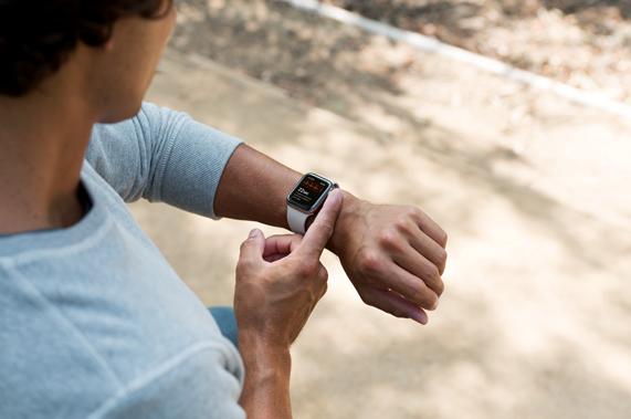 A customer taking an ECG reading on Apple Watch.