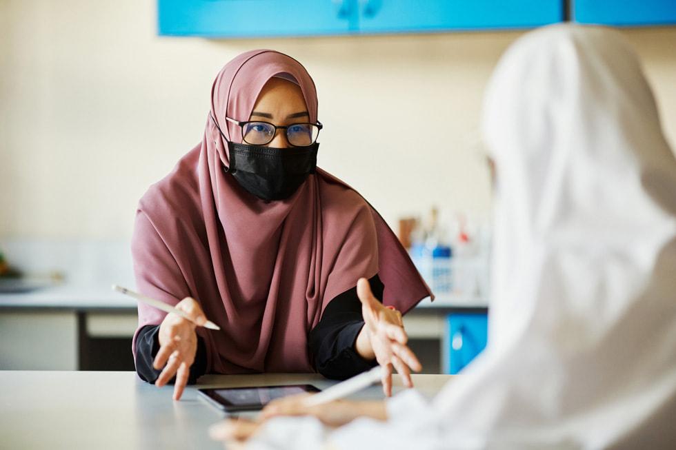 Shuhannah bte Sajali teaching a student at Madrasah Alsagoff Al-Arabiah.