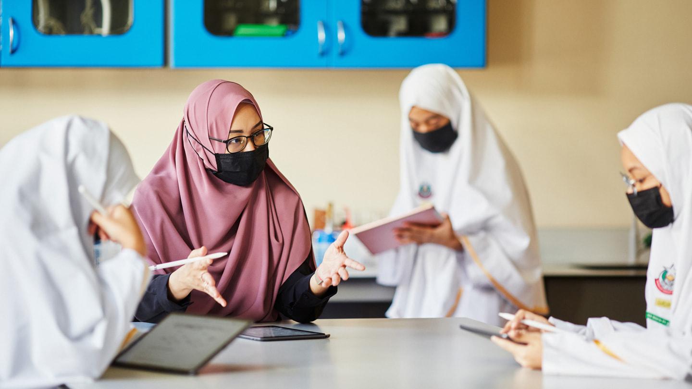 Shuhannah bte Sajali teaching students at Madrasah Alsagoff Al-Arabiah.
