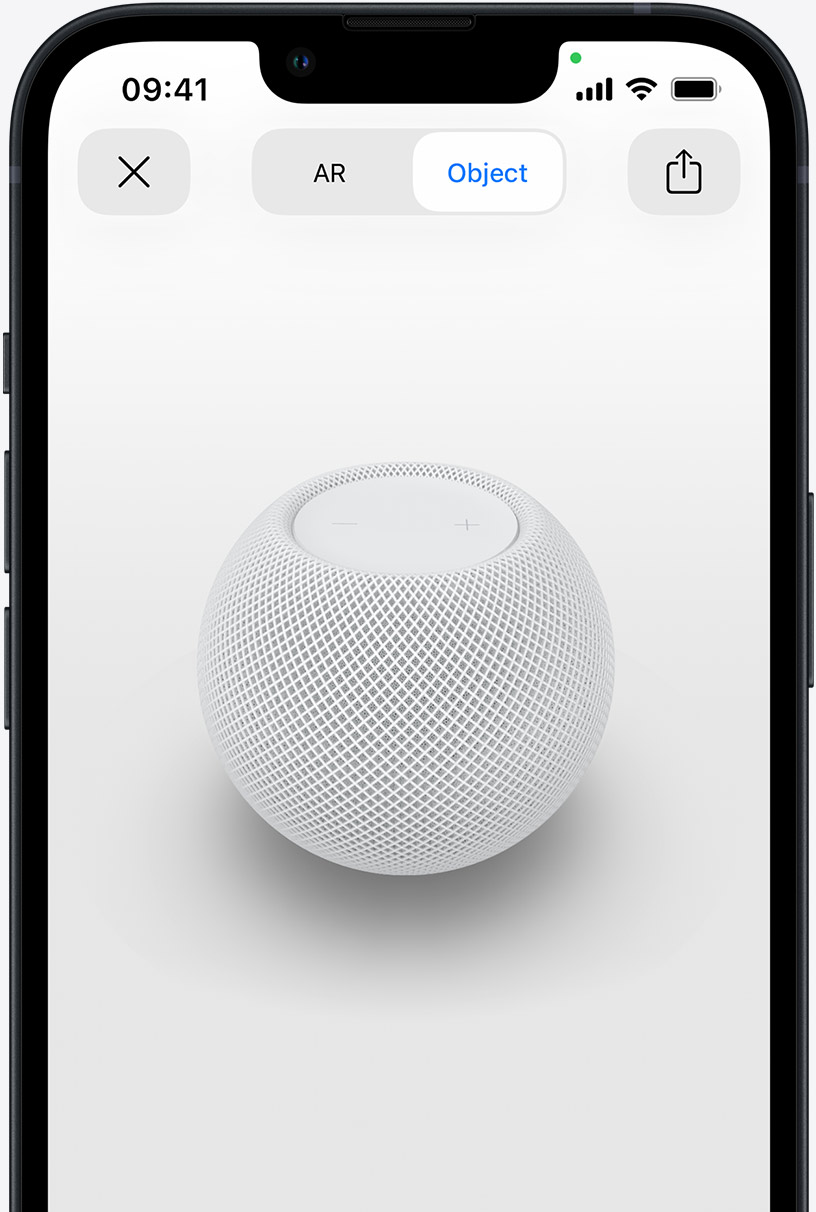 White HomePod on the screen of an iPhone in AR view.