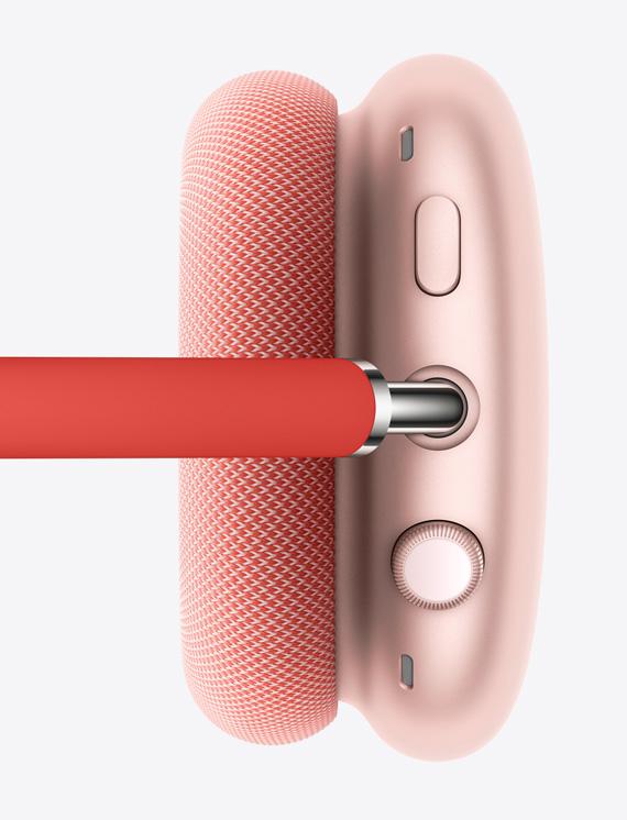 Наизображении показан правый наушник розового цвета сколёсиком DigitalCrown икнопкой управления шумоподавлением