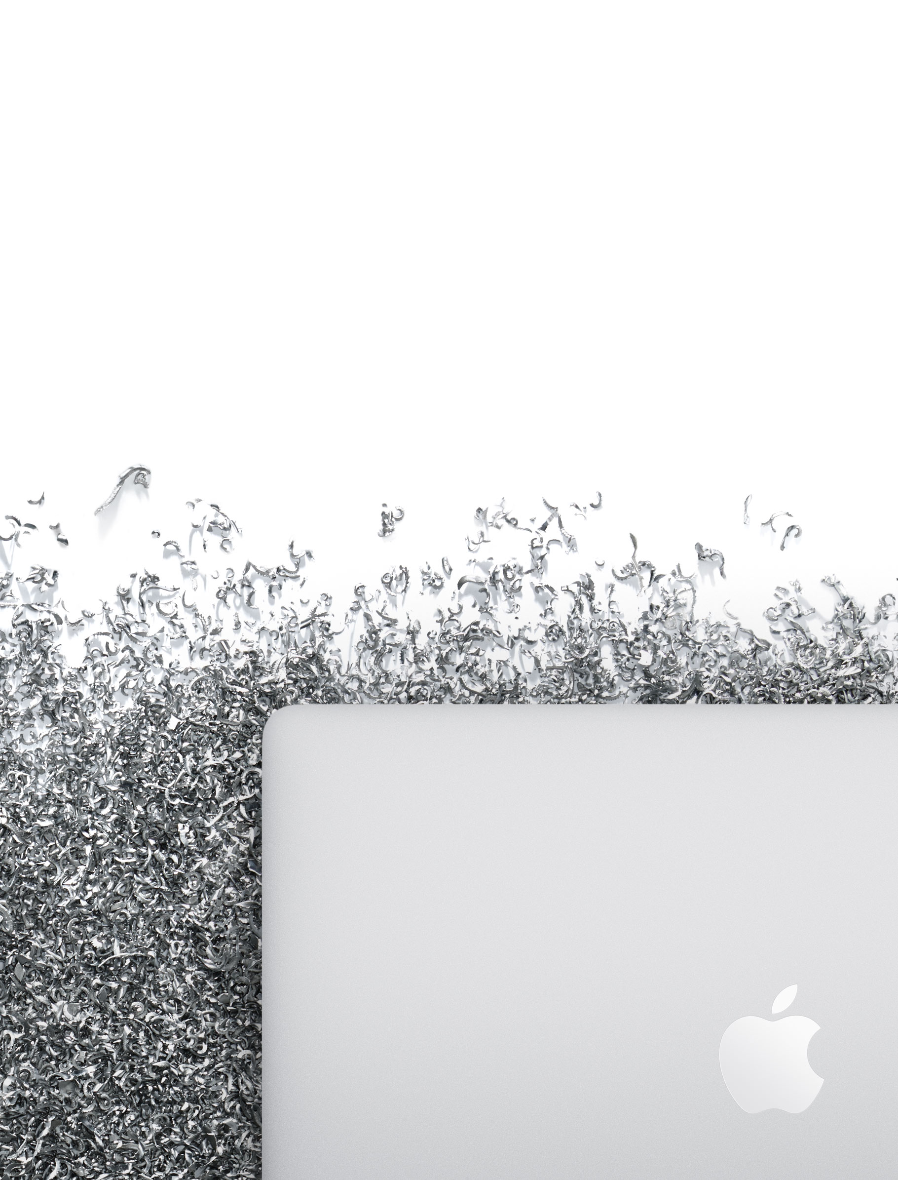 MacBook Pro surrounded by aluminium shavings