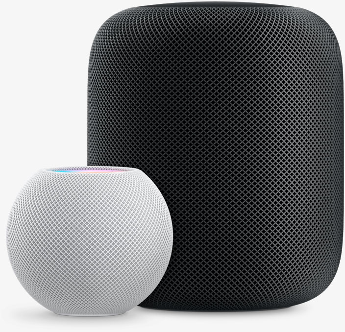 White HomePod mini in front and to the left of a Space Grey HomePod.